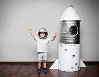 Happy child dressed in an astronaut costume Stock Images