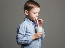 Happy Child drinking milk.Little smiling Boy enjoy milk cocktail royalty free stock images