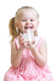 Happy child drinking milk or yogurt. Happy child girl drinking milk or yogurt from glass isolated Royalty Free Stock Photography