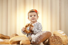 Happy child eating bread Royalty Free Stock Image