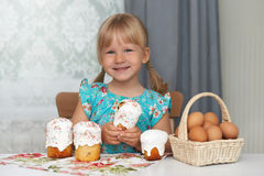Happy child eating easter cake and eggs Royalty Free Stock Photos