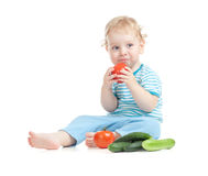 Happy child eating healthy food Royalty Free Stock Photos