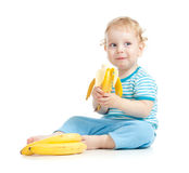 Happy child eating healthy food fruits stock photography