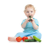 Happy child eating healthy food vegetables stock photography