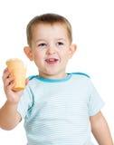 Happy child eating ice-cream isolated Stock Photos