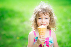 Happy child eating ice cream Royalty Free Stock Images