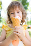 Happy child eating ice cream Stock Image