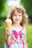 Happy child eating ice cream Royalty Free Stock Photography