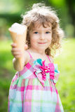 Happy child eating ice cream Stock Images