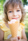 Happy child eating ice cream Royalty Free Stock Photos