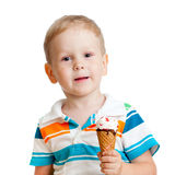 Happy child eating ice-cream in studio isolated Stock Images