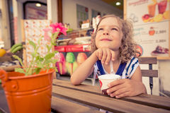 Happy child eating ice-cream Stock Image