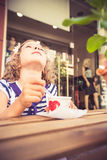 Happy child eating ice-cream Stock Images