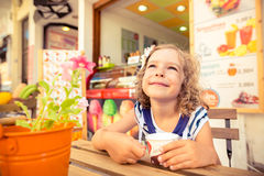 Happy child eating ice-cream Stock Photo