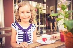 Happy child eating ice-cream Royalty Free Stock Photo
