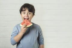 Happy child eating watermelon stock photos