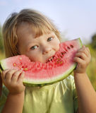 Happy child eating watermelon Royalty Free Stock Photos