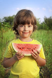 Happy child eating watermelon Stock Photo