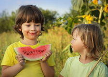 Happy child eating watermelon in the garden Royalty Free Stock Photo