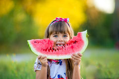 Happy child eating watermelon Stock Photography
