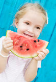 Happy child eating watermelon outdoors Stock Photography