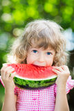 Happy child eating watermelon Royalty Free Stock Photography