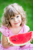 Happy child eating watermelon Stock Image