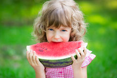 Happy child eating watermelon Royalty Free Stock Photo