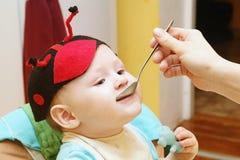 Happy child eats Royalty Free Stock Photo