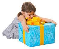 Happy child embraces large birthday gift Royalty Free Stock Image