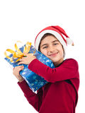 Happy child embracing his present with love Stock Photos