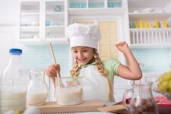 Happy child enjoying baking at home Stock Photos