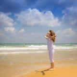 Happy child enjoying at the beach Stock Image