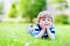 Happy child enjoying on grass field and dreaming Royalty Free Stock Photo