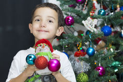 Happy Child enjoying at home at Christmas Royalty Free Stock Images