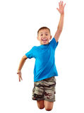 Happy child exercising and jumping Stock Image