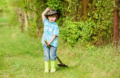 Happy child farmer play with garden shovel, spring. earth day. Eco life. summer activity. small kid gardener having fun. Human and nature. farming and royalty free stock images