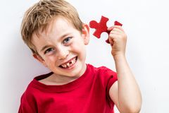 Happy child finding jigsaw for concept of solution to healthcare stock images