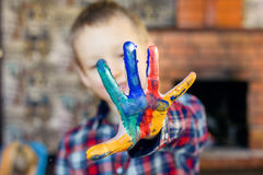 Happy child with fingers paint beautiful education Royalty Free Stock Photos