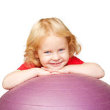 Happy child with fitness ball playing sports. Stock Photos