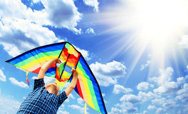 Happy child flies a kite in the sky 2 Stock Photo