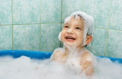 Happy child in foam Royalty Free Stock Photography