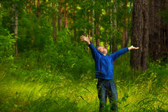 Happy child in forest (park) Royalty Free Stock Photos