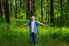 Happy child in forest (park) Stock Photos