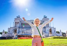 Happy child in front of Palazzo Venezia in Rome, Italy rejoicing. Roman Holiday. Portrait of smiling stylish child in the front of Palazzo Venezia in Rome, Italy royalty free stock image