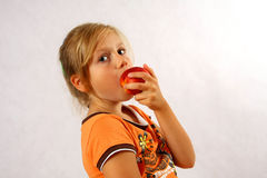 Happy Child with a fruit Stock Image