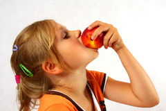 Happy Child with a fruit Stock Images