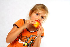 Happy Child with a fruit Royalty Free Stock Image