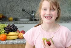 Happy child with fruits Stock Photos