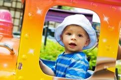 Happy child in funfair Stock Photo